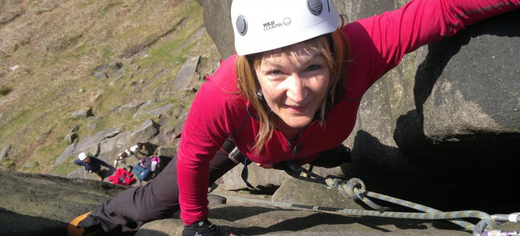 rock climber on Martello Cracks at Stanage Edge