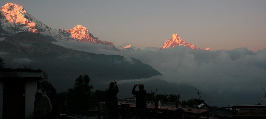 Annapurna Base Camp Trek image of trekkers looking at the peak of Machupachare