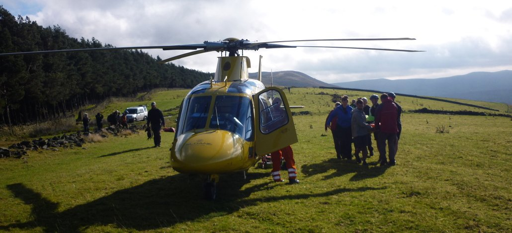Image showing HEMs unit assisting Edale Mountain Rescue with a mountain biker who had broken her arm. Peak District, October 2011.