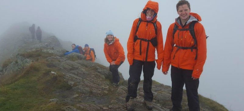 Picture of walkers smiling on a wet day walking in the Lake District