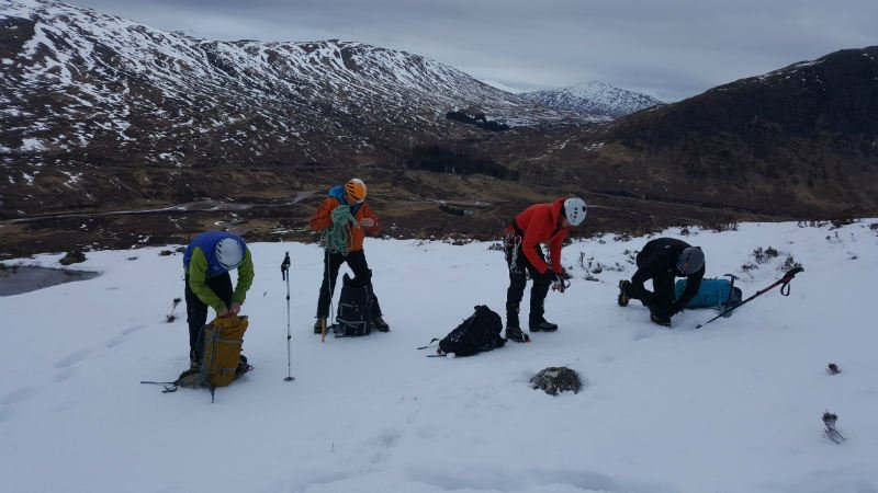 image showing four climbers getting ready to climb in snowy Scottish mountains of Glen Coe