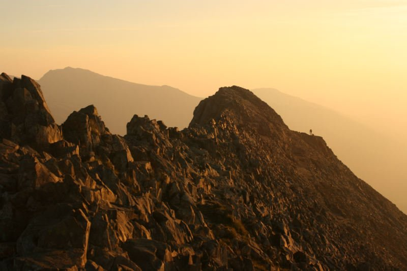 Sun rise on Crib Goch showing the mountainside in a red hue