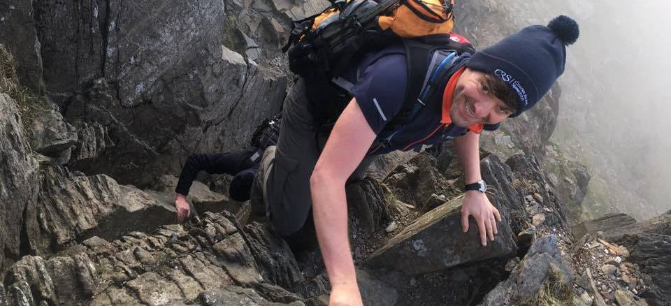 image showing a corporate client enjoying the Welsh 3000s challenge with Will4Adventure whilst scrambling on Crib Goch in Snowodnia