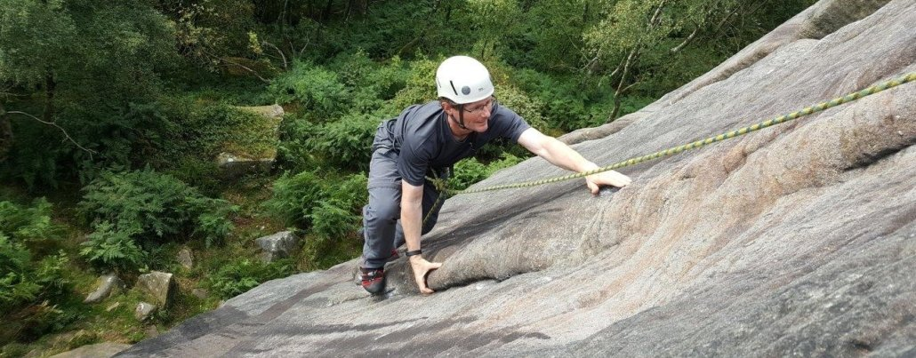 rock climber on Sunset Slab in the Peak District