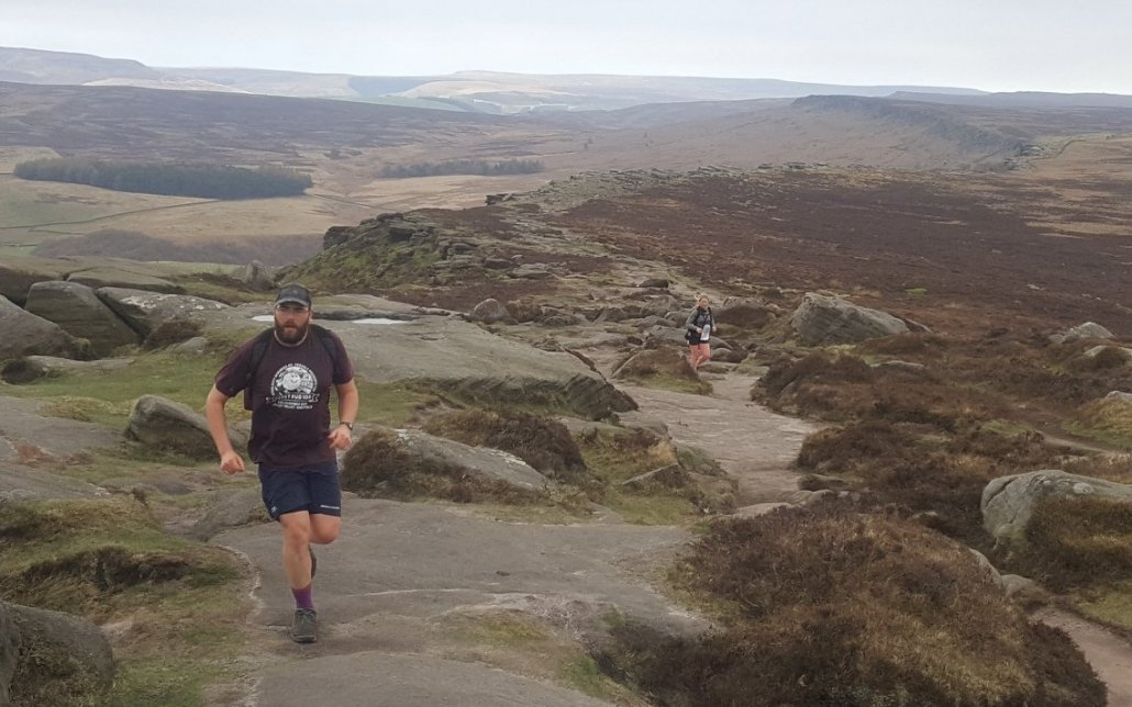 image showing a runner taking part a charity challenge event in the Peak District