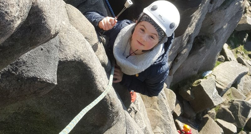 My daughter seconding her first climb at Stanage Edge in the Peak District