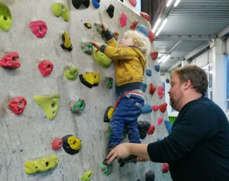 Father helps his son manage his first climb at the Mini Works in Sheffield