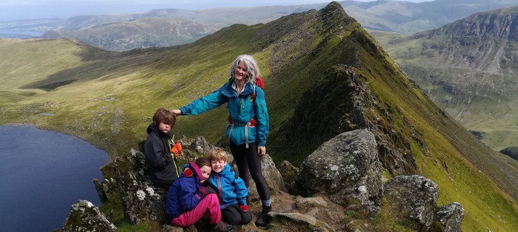 image of a family posing on Striding Edge in the Lake District