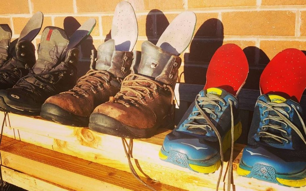image of walking boots and running trainers