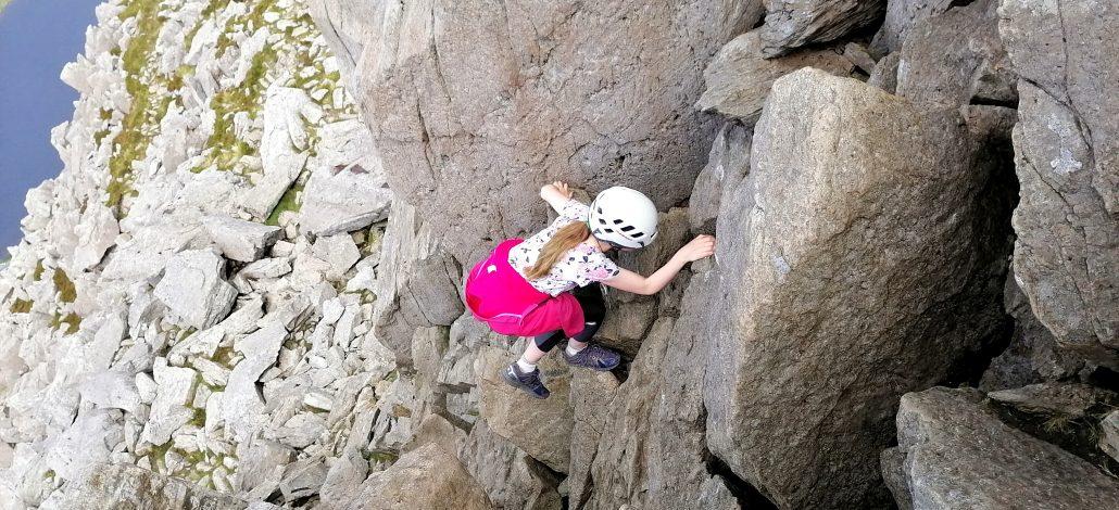 Jocelyn with helmet scrambling on Tryfan in Snowdonia