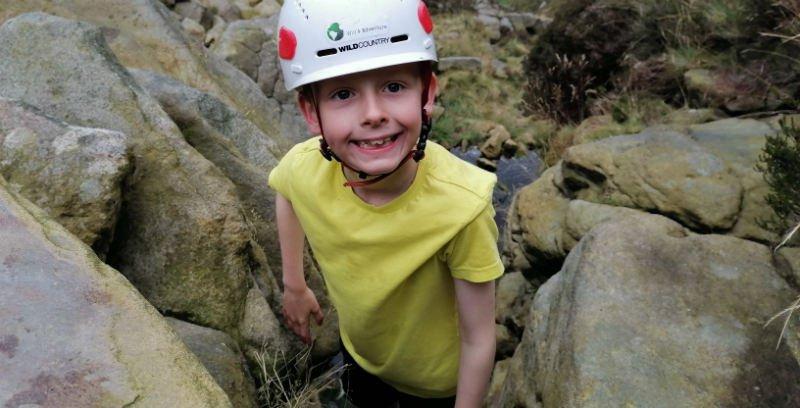 Alex scrambling up Crowden Clough in the Peak District