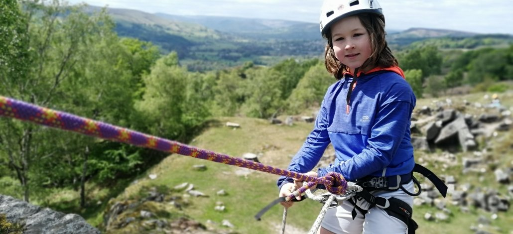 8 year old Patrick abseiling in the Peak District