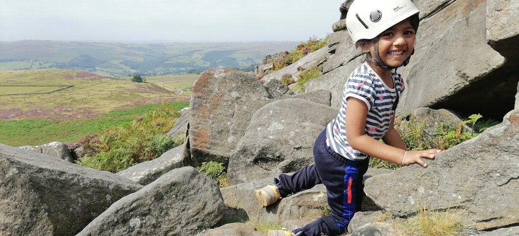 child playing on the rocks in the Peak District