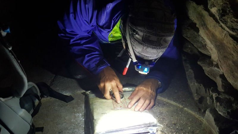 mountain leader trainee practicing advanced map reading and night navigation skills in the Snowdonia