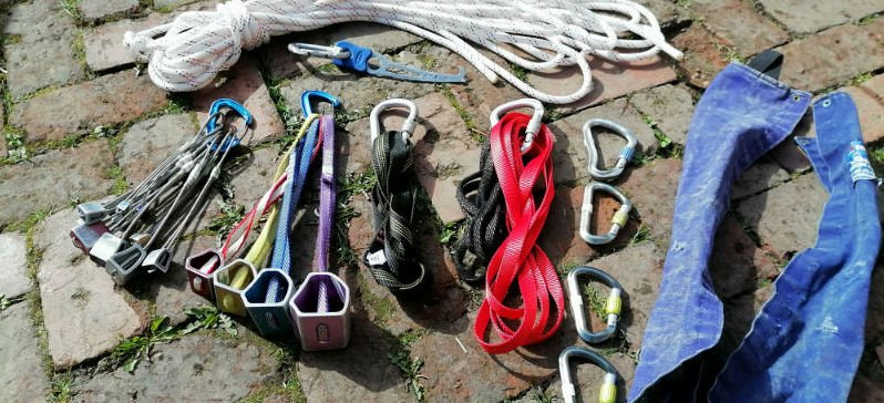 image of static rope and rock climbing equipment for rigging a rock climb